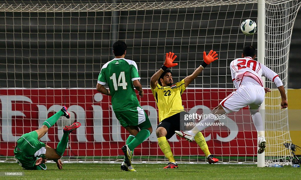 Ali Salem (R) of UAE head the ball in front of Iraq's goalkeeper during the 21st Gulf Cup's final between United Arab Emirates (UAE) and Iraq on January 18, 2013 in Manama. United Arab Emirates won 2-1 against Iraq.
