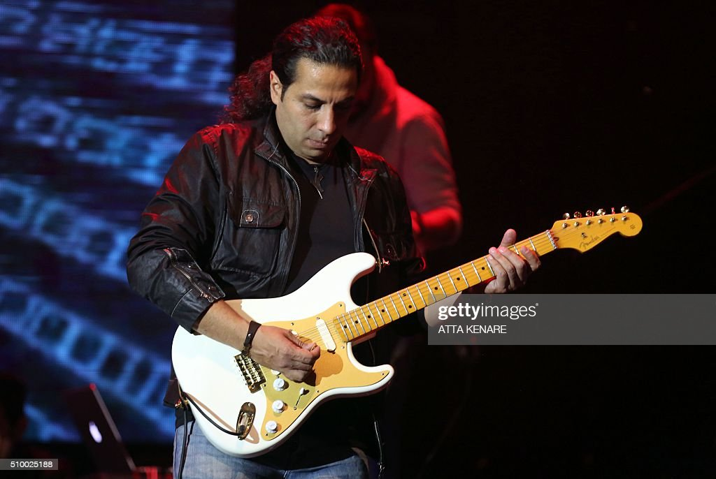 Ali shahbazi, guitarist for Iranian pop singer Mohammad Alizadeh, performs on stage during the 31th Fajr International Music Festival in the capital Tehran, on February 13, 2016. / AFP / ATTA KENARE