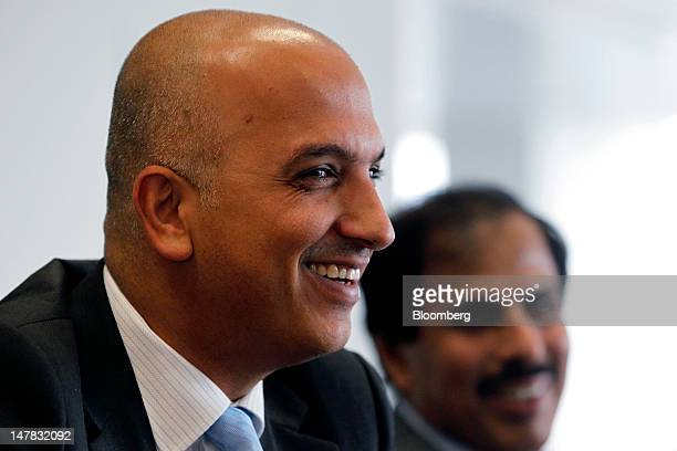 Ali Shareef Al Emadi group chief executive officer of Qatar National Bank SAQ left sits with Sheikh Abdullah Saud Al Thani governor of Qatar's...
