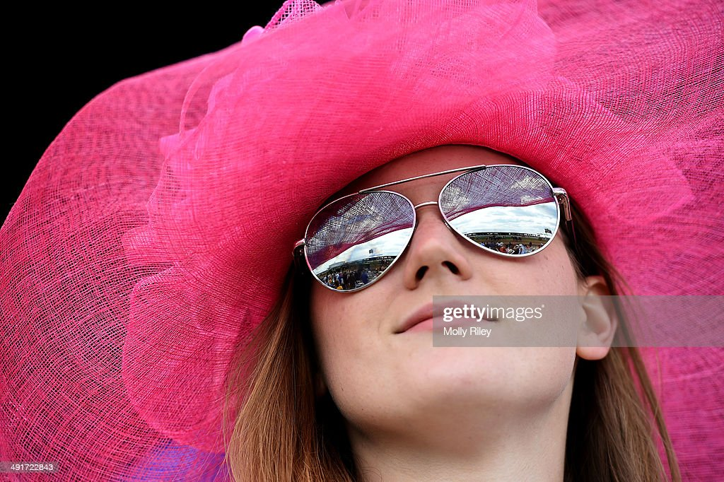Ali Shepard of Alexandria Virginia wears a decorative hat prior to the 139th running of the Preakness Stakes at Pimlico Race Course on May 17 2014 in...