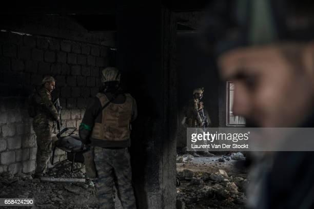 Ali the liaison officer he will be wounded at the end of the day and soldiers of the Iraqi Federal Police Emergency Response Division during a battle...