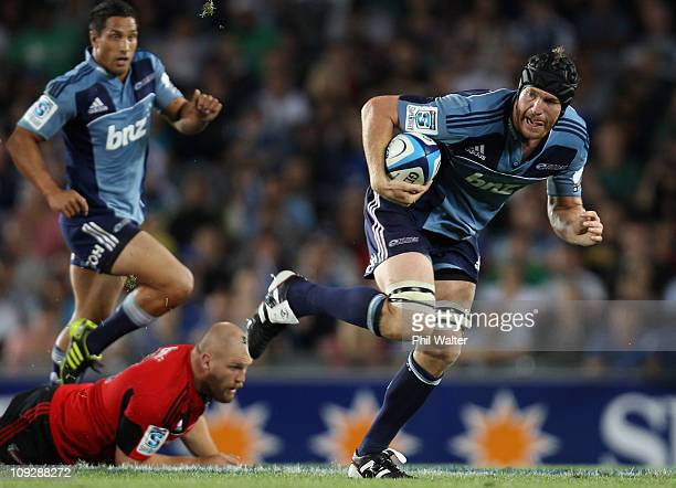 Ali Williams of the Blues runs the ball past the tackle of Ben Franks of the Crusaders during the round one Super Rugby match between the Blues and...