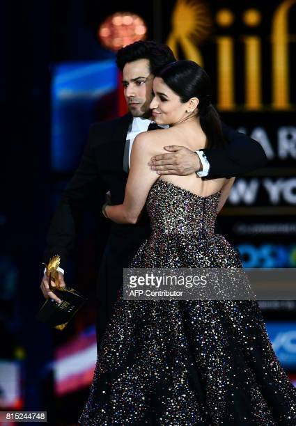 Alia Bhatt reacts after learning she got the award for Best Actress as she arrives with Varun Dhawan on stage during the IIFA Awards July 15 2017 at...