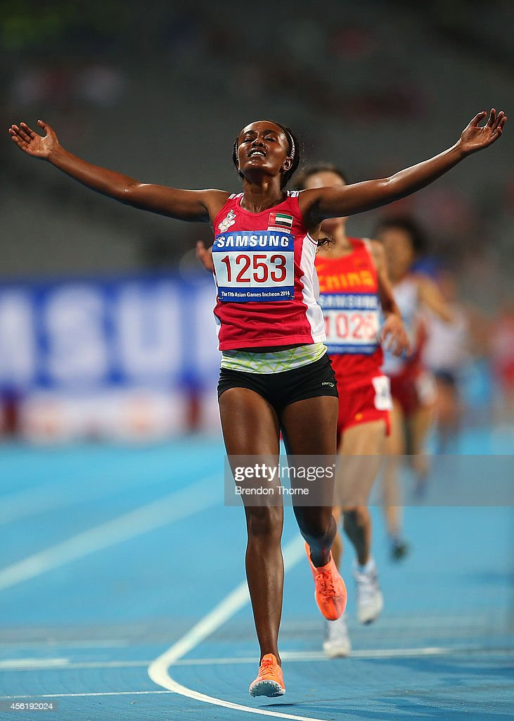 Alia Mohammed Saeed Mohammed of UAE celebrates after claiming the Gold medal following the Women's 10,000m Final during day eight of the 2014 Asian Games at Incheon Asiad Main Stadium on September 27, 2014 in Incheon, South Korea.