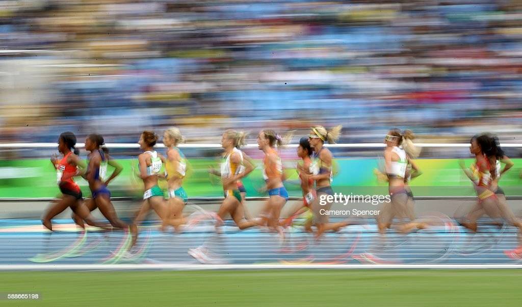 Alia Saeed Mohammed of United Arab Emirates leads a group in the Women's 10000 metres final on Day 7 of the Rio 2016 Olympic Games at the Olympic...
