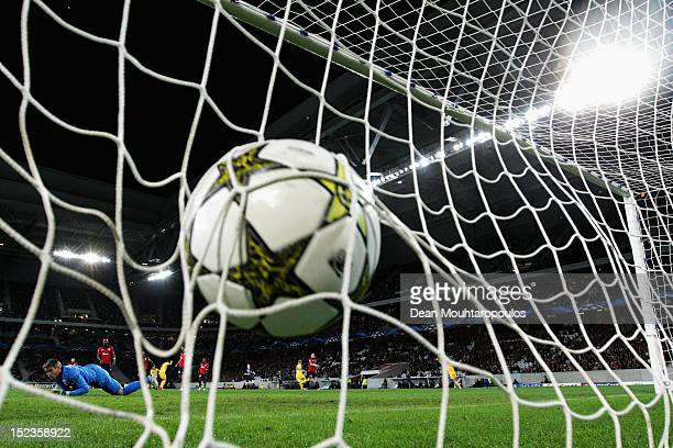 Aliaksandr Volodko of BATE shoots and scores the first goal of the game during the Group F UEFA Champions League match between LOSC Lille Metropole...