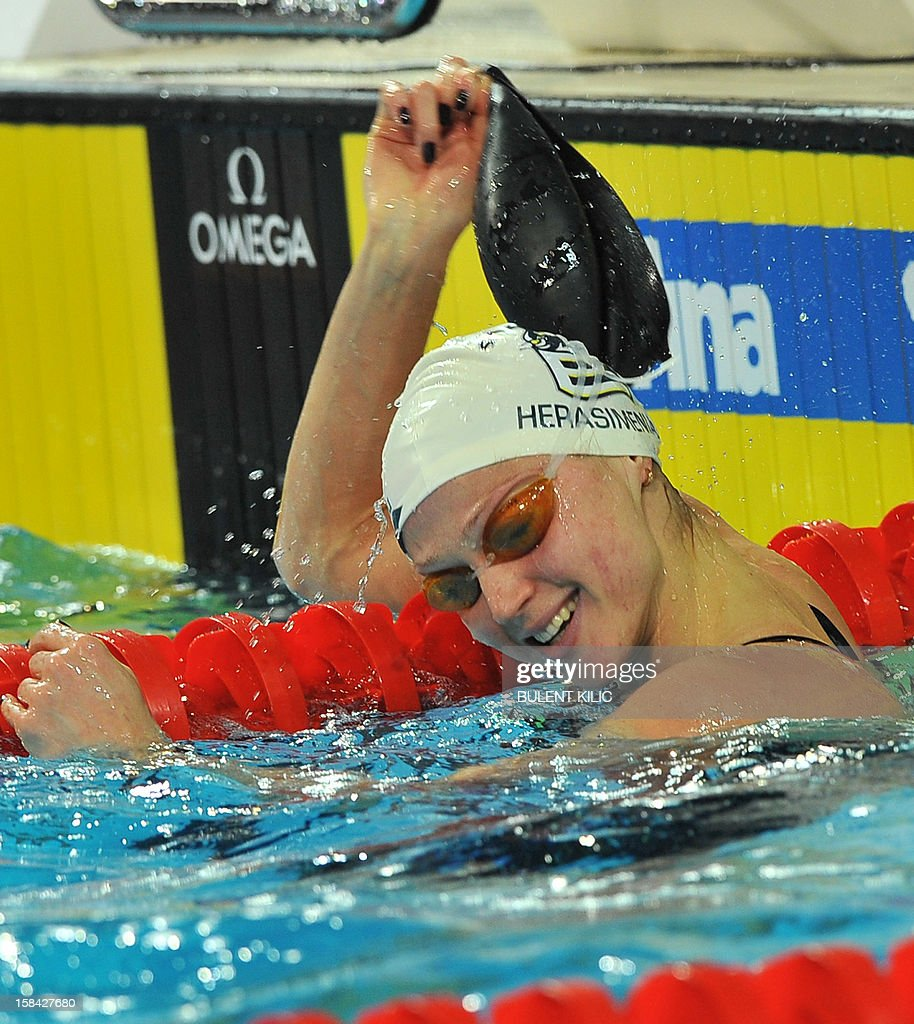 Aliaksandra Herasimenia of Belarus celebrates her gold medal in the women's 50m freestyle final during the Short Course Swimming World Championships in Istanbul on December 16, 2012.