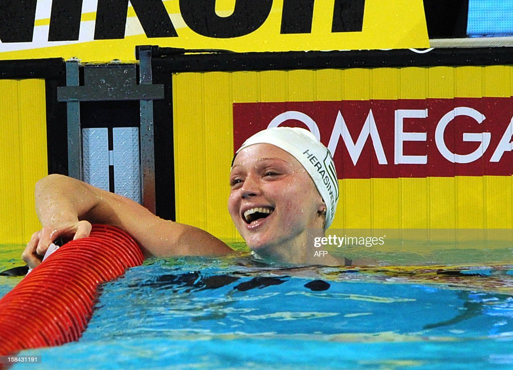 Aliaksandra Herasimenia of Belarus celebrates her gold medal in the women's 50m freestyle final during the Short Course Swimming World Championships in Istanbul on December 16, 2012. AFP PHOTO/MIRA