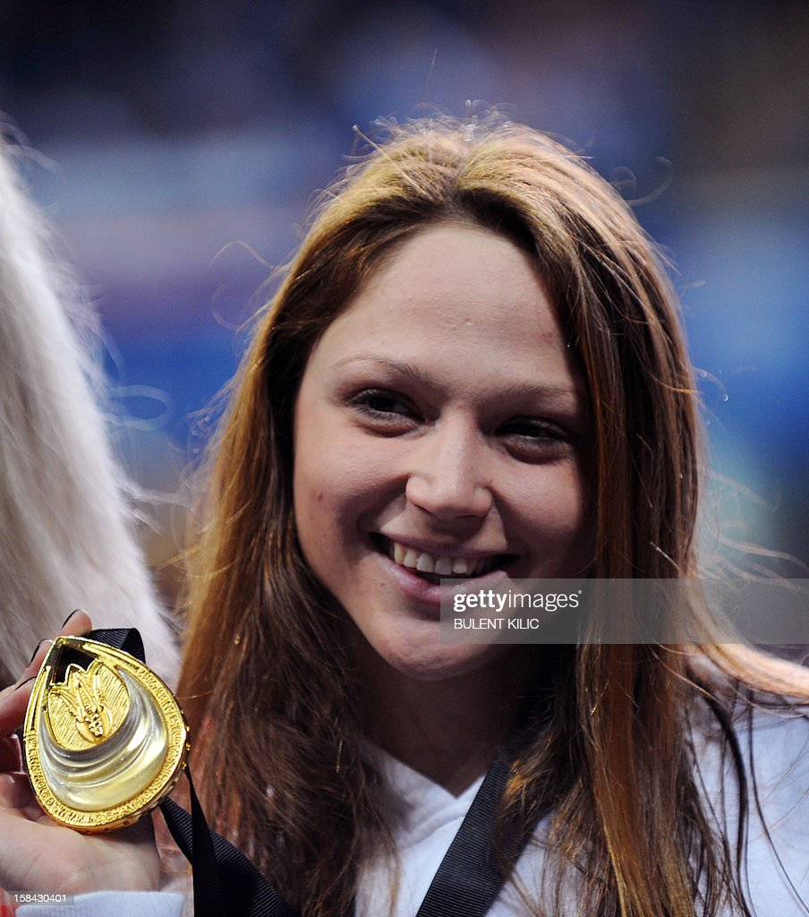 Aliaksandra Herasmenia of Belarus celebrates her gold medal after the women`s 50m freestyle final during the Short Course Swimming World Championships in Istanbul on December 16, 2012.