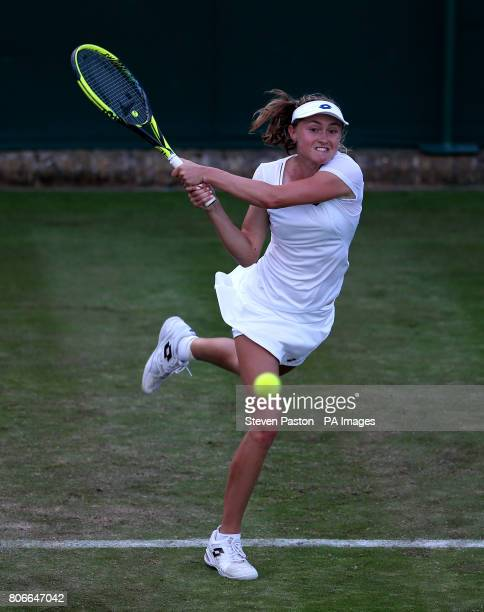 Aliaksandra Sasnovich in action against Jelena Ostapenko on day one of the Wimbledon Championships at The All England Lawn Tennis and Croquet Club...