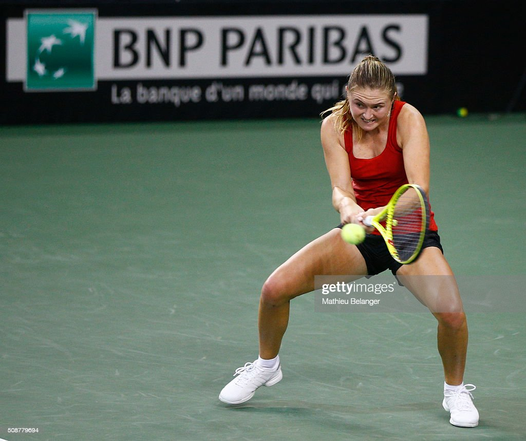 <a gi-track='captionPersonalityLinkClicked' href=/galleries/search?phrase=Aliaksandra+Sasnovich&family=editorial&specificpeople=7071481 ng-click='$event.stopPropagation()'>Aliaksandra Sasnovich</a> of Belarus returns a ball to Francoise Abanda of Canada during their Fed Cup BNP Paribas match at Laval University in Quebec City on February 6, 2016 in Quebec City, Quebec, Canada.