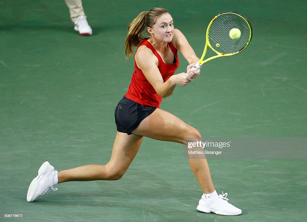Aliaksandra Sasnovich of Belarus returns a ball to Francoise Abanda of Canada during their Fed Cup BNP Paribas match at Laval University in Quebec City on February 6, 2016 in Quebec City, Quebec, Canada.