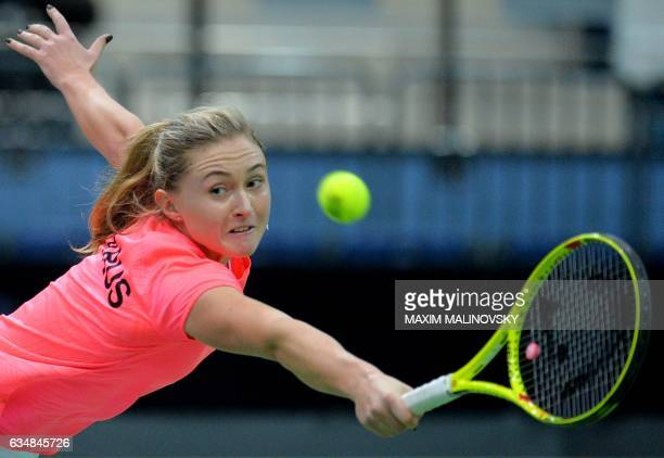 Aliaksandra Sasnovich of Belarus returns the ball to Kiki Bertens of The Netherlands during the Fed Cup World Group first round tennis match between...