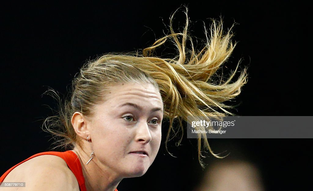 <a gi-track='captionPersonalityLinkClicked' href=/galleries/search?phrase=Aliaksandra+Sasnovich&family=editorial&specificpeople=7071481 ng-click='$event.stopPropagation()'>Aliaksandra Sasnovich</a> of Belarus serves to Francoise Abanda of Canada during their Fed Cup BNP Paribas match at Laval University in Quebec City on February 6, 2016 in Quebec City, Quebec, Canada.