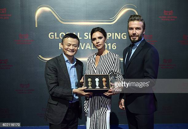 Alibaba chairman Jack Ma British fashion designer Victoria Beckham and British former footballer David Beckham pose for a photo during a dress...