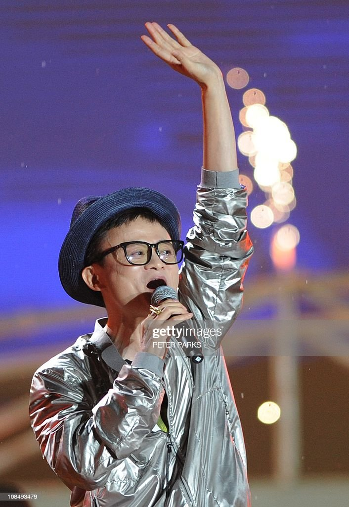 Alibaba chief Jack Ma dresses as a pop star and sings at an event to mark the 10th anniversary of China's most popular online shopping destination Taobao Marketplace, in Hangzhou on May 10. 2013. As Ma steps aside after building the world's largest online retailer, the Chinese firm is preparing a huge stock offer prompting comparisons with Facebook -- whose profits it dwarfs. AFP PHOTO/Peter PARKS
