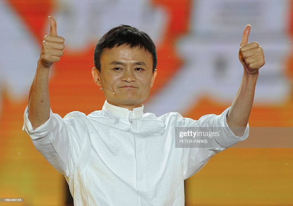 Alibaba founder Jack Ma gives a thumbs up after speaking at an event to mark the 10th anniversary of China's most popular online shopping destination Taobao Marketplace in Hangzhou on May 10, 2013. As Ma steps aside after building the world's largest online retailer, the Chinese firm is preparing a huge stock offer prompting comparisons with Facebook -- whose profits it dwarfs. AFP PHOTO/Peter PARKS