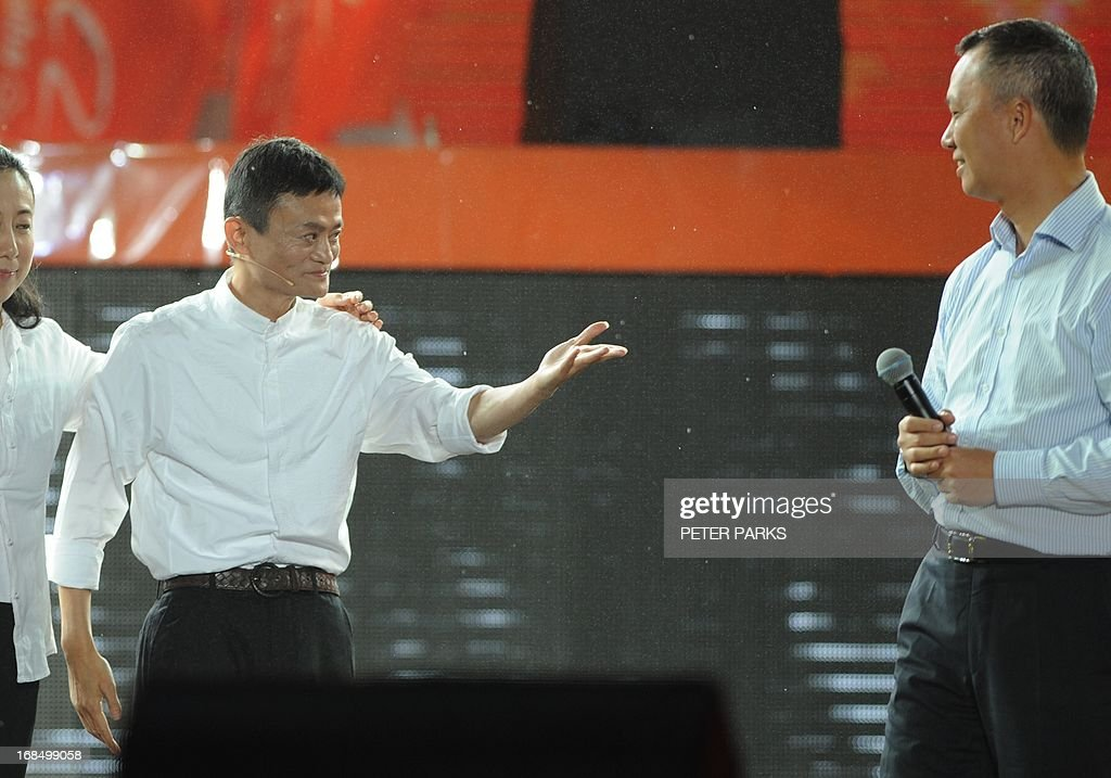 Alibaba founder Jack Ma (2nd L) introduces new CEO Lu Zhaoxi (R) at an event to mark the 10th anniversary of China's most popular online shopping destination Taobao Marketplace in Hangzhou on May 10, 2013. As Ma steps aside after building the world's largest online retailer, the Chinese firm is preparing a huge stock offer prompting comparisons with Facebook -- whose profits it dwarfs. AFP PHOTO/Peter PARKS
