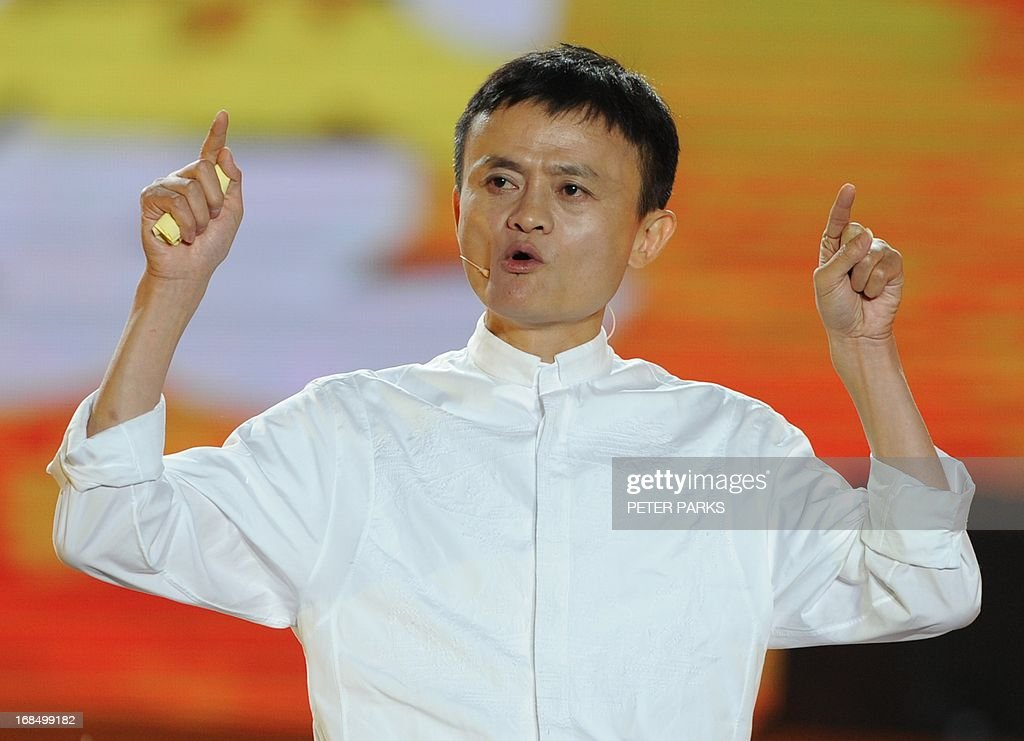 Alibaba founder Jack Ma speaks at an event to mark the 10th anniversary of China's most popular online shopping destination Taobao Marketplace in Hangzhou on May 10, 2013. As Ma steps aside after building the world's largest online retailer, the Chinese firm is preparing a huge stock offer prompting comparisons with Facebook -- whose profits it dwarfs. AFP PHOTO/Peter PARKS