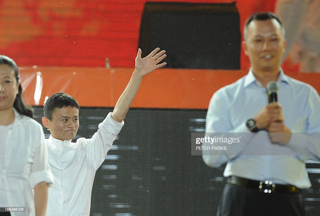 Alibaba founder Jack Ma (2nd L) waves goodbye as new CEO Lu Zhaoxi (R) prepares to speak an event to mark the 10th anniversary of China's most popular online shopping destination Taobao Marketplace in Hangzhou on May 10, 2013. As Ma steps aside after building the world's largest online retailer, the Chinese firm is preparing a huge stock offer prompting comparisons with Facebook -- whose profits it dwarfs. AFP PHOTO/Peter PARKS