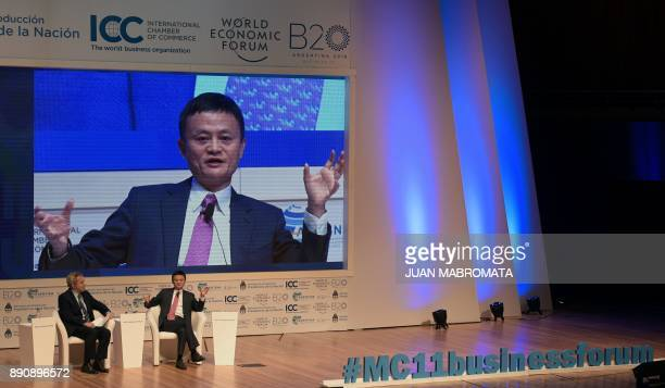Alibaba Group Executive Chairman Jack Ma talks next to the head of Global Agenda Richard Samans during the Business Forum of the 11th Ministerial...