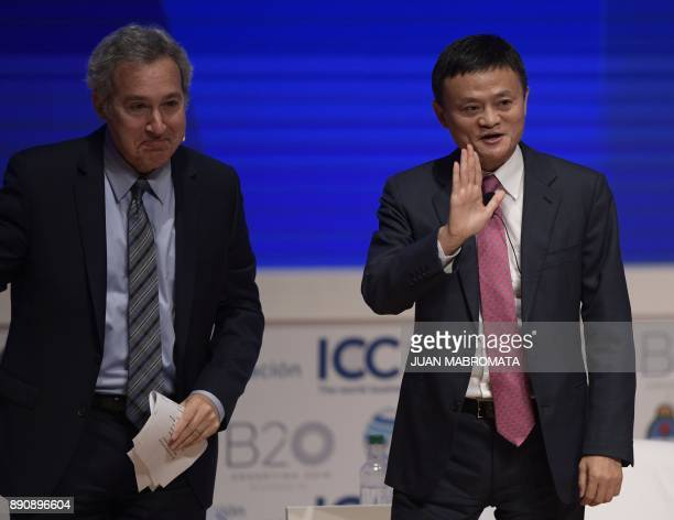 Alibaba Group Executive Chairman Jack Ma waves next to the head of Global Agenda Richard Samans during the Business Forum of the 11th Ministerial...