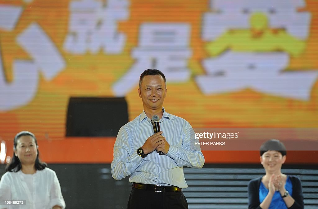 Alibaba's new CEO Lu Zhaoxi (C) speaks at an event to mark the 10th anniversary of China's most popular online shopping destination Taobao Marketplace in Hangzhou on May 10, 2013. As Ma steps aside after building the world's largest online retailer, the Chinese firm is preparing a huge stock offer prompting comparisons with Facebook -- whose profits it dwarfs. AFP PHOTO/Peter PARKS