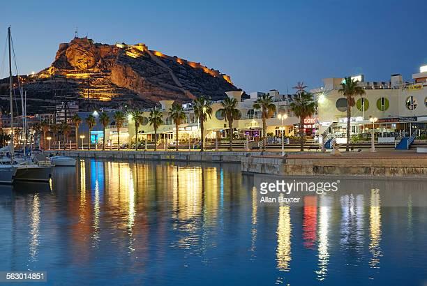 Alicante port illuminated at dusk
