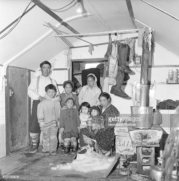 'Alice an Inuit woman posing with her family Resolute 1959 '