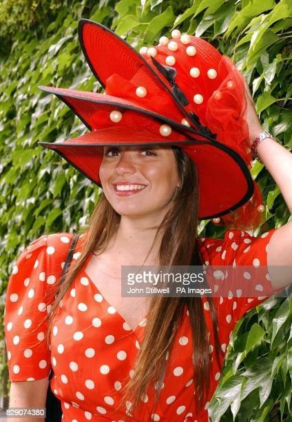 Alice Ascoli from Milan Italy holds on to her hat as the breeze picks up before the start of the third day's racing at Royal Ascot in Berkshire...