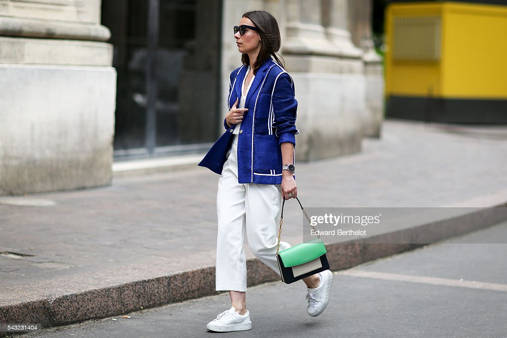 Alice Barbier (fashion blogger - J'aime tout chez toi), is wearing an Acne blue coat, Zara white pants, and a Lancel green and black bag, before the Paul Smith show, during Paris Fashion Week Menswear Spring/summer 2017, on June 26, 2016 in Paris, France.