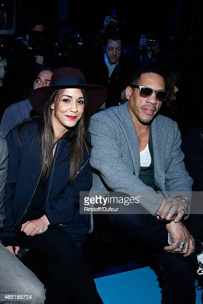 Alice Belaidi and JoeyStarr attend the ETAM show as part of the Paris Fashion Week Womenswear Fall/Winter 2015/2016 Held at Piscine Molitor on March...