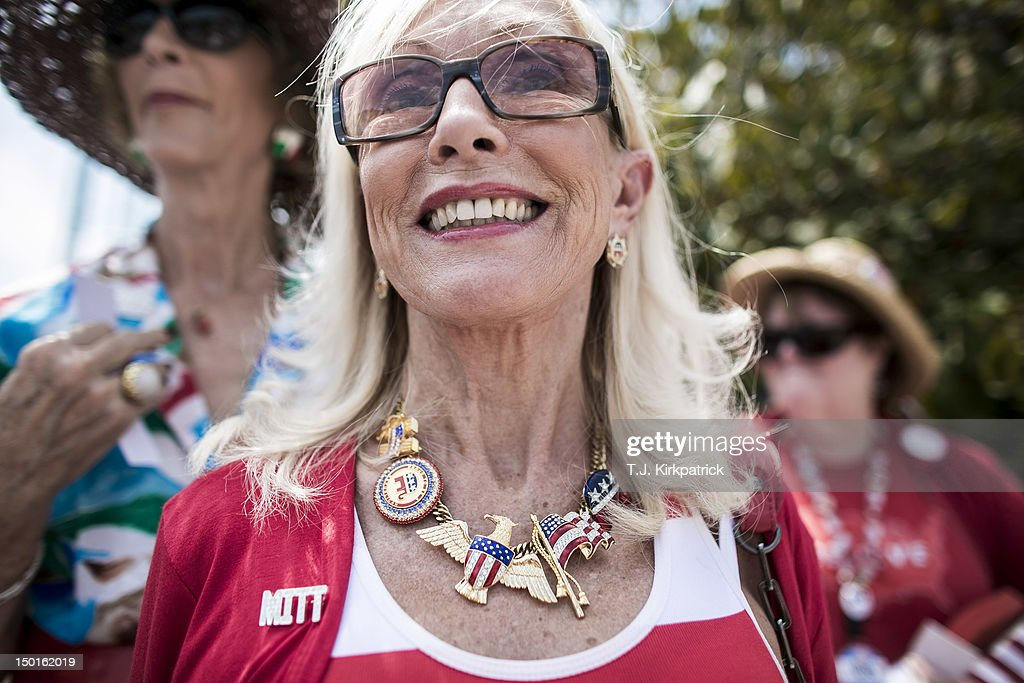 Alice Butler-Short, of Norton, Virginia, center, wears a homemade necklace while waiting in line to enter the Harris Pavilion to hear Republican presidential candidate, former Massachusetts Gov. Mitt Romney speak at a campaign rally with newly appointed vice presidential candidate, U.S. Rep. Paul Ryan (R-WI) on August 11, 2012 in Manassas, Virginia. 'He couldn't have done better,' Butler-Short said of Romney's pick of Ryan for a running mate, adding, 'we're gonna rock and roll with R and R.' Ryan, a seven term congressman, is Chairman of the House Budget Committee and provides a strong contrast to the Obama administration on fiscal policy.