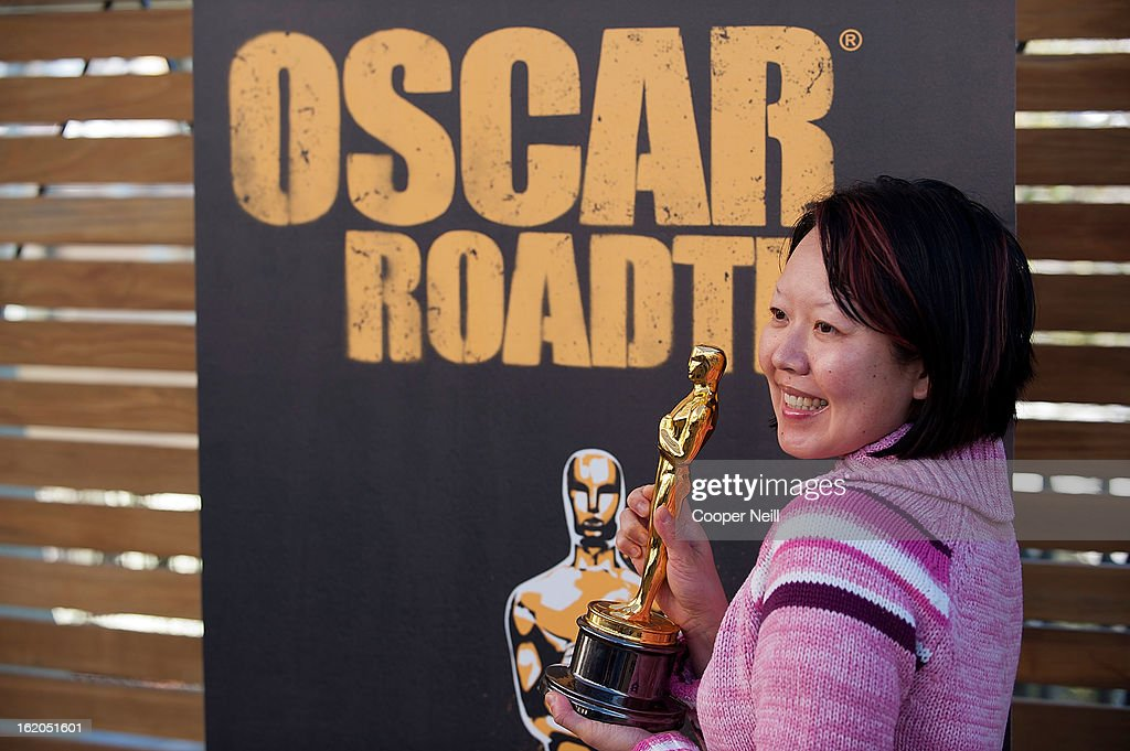 Alice Chien poses with an Oscar trophey during First-Ever Oscar Roadtrip at the Angelika Film Center on February 18, 2013 in Dallas.