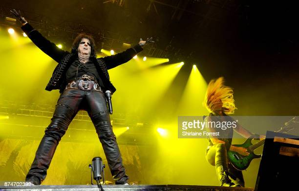 Alice Cooper and guitarist Nita Strauss perform live on stage at Manchester Arena on November 15 2017 in Manchester England