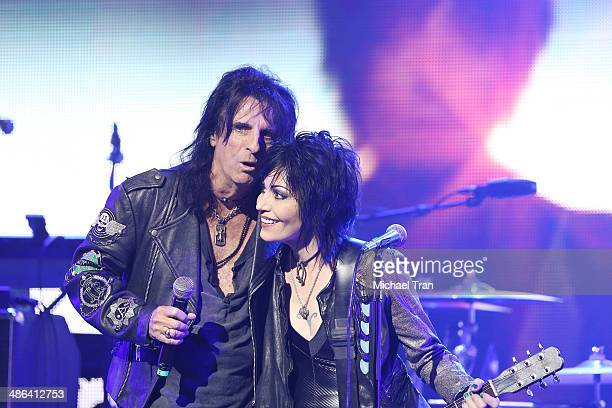 Alice Cooper and Joan Jett speak onstage during the 6th Annual Revolver Golden Gods Award Show held at Club Nokia on April 23 2014 in Los Angeles...