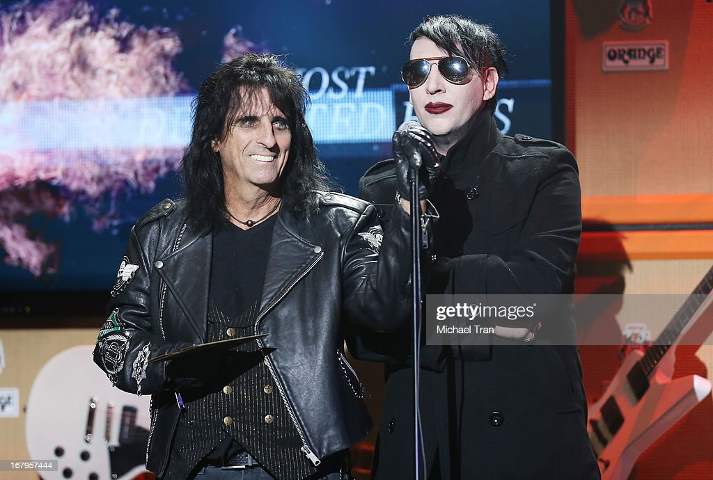 <a gi-track='captionPersonalityLinkClicked' href=/galleries/search?phrase=Alice+Cooper&family=editorial&specificpeople=202989 ng-click='$event.stopPropagation()'>Alice Cooper</a> (L) and <a gi-track='captionPersonalityLinkClicked' href=/galleries/search?phrase=Marilyn+Manson&family=editorial&specificpeople=208980 ng-click='$event.stopPropagation()'>Marilyn Manson</a> present the 'Most Dedicated Fans' award at the 5th Annual Revolver Golden Gods Award Show held at Club Nokia on May 2, 2013 in Los Angeles, California.
