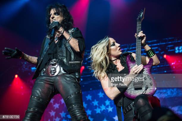 Alice Cooper and Nita Strauss at Wembley Arena on November 16 2017 in London England