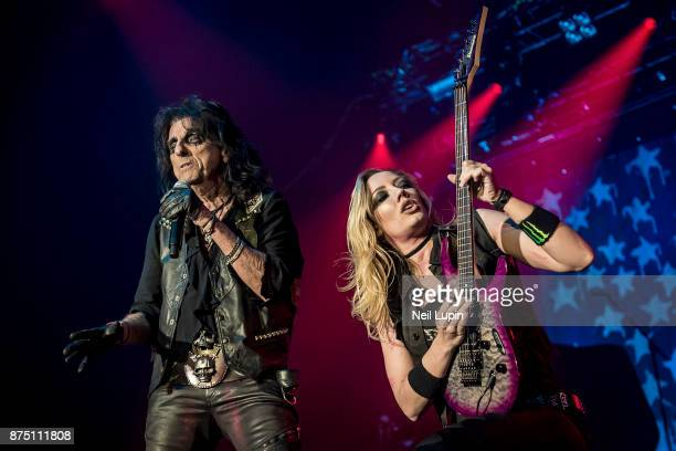 Alice Cooper and Nita Strauss perform at Wembley Arena on November 16 2017 in London England