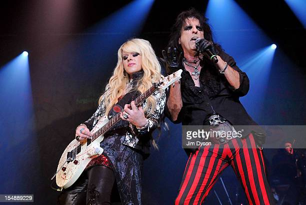 Alice Cooper and Orianthi Panagaris perform live on stage during the 'Halloween Night Of Fear' Tour at Wembley Arena on October 28 2012 in London...