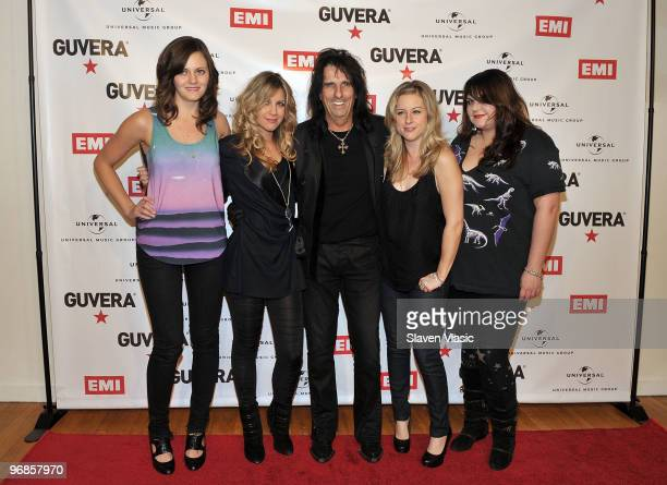 Alice Cooper poses withThe Donnas band members Brett Anderson Allison Robertson Torry Castellano and Maya Ford with singer Alice Cooper attend the...