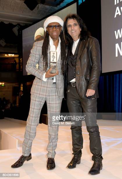 Alice Cooper presents Nile Rodgers with the Raymond Weil International Award at the Nordoff Robbins O2 Silver Clef Awards at The Grosvenor House...
