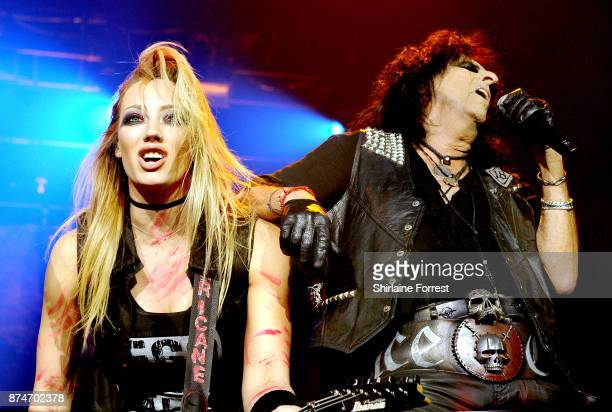 Alice Cooper with guitarist Nita Strauss perform live on stage at Manchester Arena on November 15 2017 in Manchester England