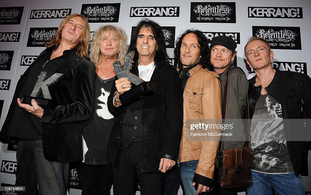 Alice Cooper (C) with his Icon award and Def Leppard with their Inspiration award during The Relentless Energy Drink Kerrang! Awards at The Brewery on June 9, 2011 in London, England.