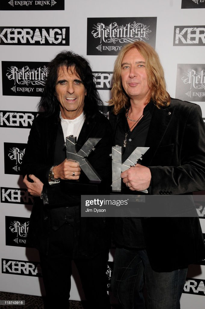 <a gi-track='captionPersonalityLinkClicked' href=/galleries/search?phrase=Alice+Cooper&family=editorial&specificpeople=202989 ng-click='$event.stopPropagation()'>Alice Cooper</a>, with the Kerrang Icon Award, and Joe Elliott of <a gi-track='captionPersonalityLinkClicked' href=/galleries/search?phrase=Def+Leppard&family=editorial&specificpeople=614448 ng-click='$event.stopPropagation()'>Def Leppard</a>, with the Kerrang Inspiration Award, pose at The Relentless Energy Drink Kerrang! Awards at The Brewery on June 9, 2011 in London, England.