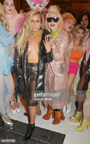 Alice Dellal and designer Pam Hogg pose with models backstage at the Pam Hogg SS18 catwalk show during London Fashion Week September 2017 on...