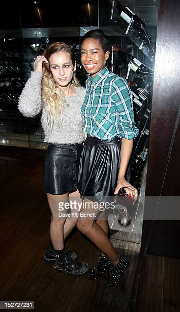 Alice Dellal and Tolula Adeyemi attend an after party following the press night performance of 'Let It Be' at DSTRKT London on September 24 2012 in...