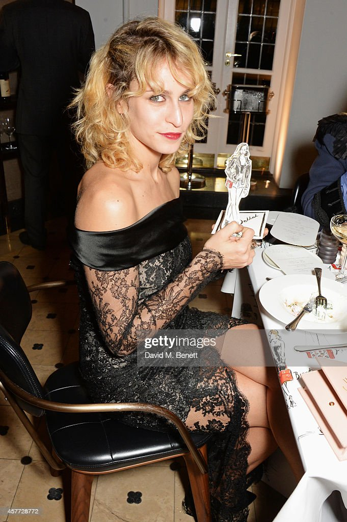 <a gi-track='captionPersonalityLinkClicked' href=/galleries/search?phrase=Alice+Dellal&family=editorial&specificpeople=4261908 ng-click='$event.stopPropagation()'>Alice Dellal</a> poses with art by Clym Evernden at the Charlotte Olympia 'Handbags for the Leading Lady' launch dinner at Toto's Restaurant on October 23, 2014 in London, England.