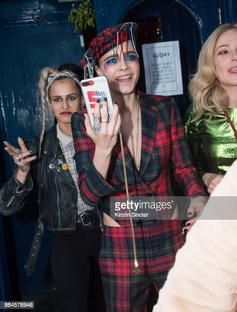 Alice Dellal with host Cara Delevingne attend the Burberry x Cara Delevingne Christmas Party on December 2 2017 in London England