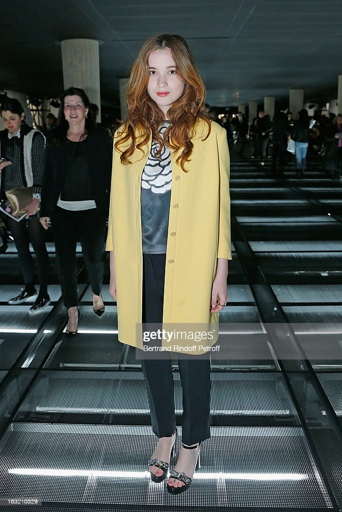 <a gi-track='captionPersonalityLinkClicked' href=/galleries/search?phrase=Alice+Englert&family=editorial&specificpeople=616562 ng-click='$event.stopPropagation()'>Alice Englert</a> arrives to attend the Miu Miu Fall/Winter 2013 Ready-to-Wear show as part of Paris Fashion Week on March 6, 2013 in Paris, France.